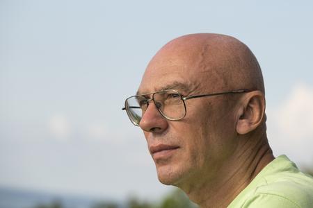 Seniors portrait, contemplative old caucasian man. Close up