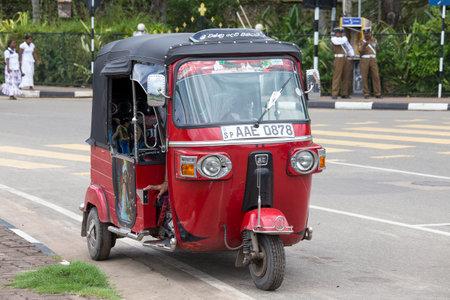 bajaj: MATARA, SRI LANKA - NOVEMBER 5, 2014: Auto rickshaw or tuk-tuk on the street of Matara. Most tuk-tuks in Sri Lanka are a slightly modified Indian Bajaj model, imported from India.