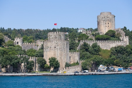 rumeli: ISTANBUL, TURKEY - JULY 29, 2015 : Rumeli Fortress on the Bosporus waterfront, Istanbul, Turkey. Rumeli Fortress one of the most popular locations on the Bosphorus.