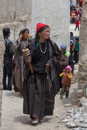 dance time: LAMAYURU, INDIA - JUNE 13, 2015: Unidentified buddhist old women during mystical mask dancing Tsam mystery dance in time of Yuru Kabgyat Buddhist festival at Lamayuru Gompa, Ladakh, North India Editorial