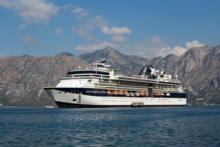 boka: KOTOR, MONTENEGRO - SEPTEMBER 23, 2015 : Large cruise ship Celebrity Constellation in Boka Kotorsky Bay. Kotor has one of the best preserved medieval old towns in the Adriatic