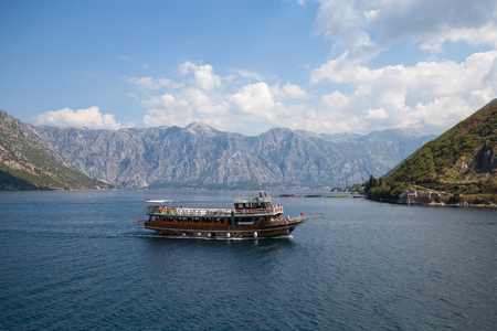 old towns: KOTOR, MONTENEGRO - SEPTEMBER 13, 2015 : Cruise ship with tourists in Boka Kotorska Bay. Kotor has one of the best preserved medieval old towns in the Adriatic Editorial