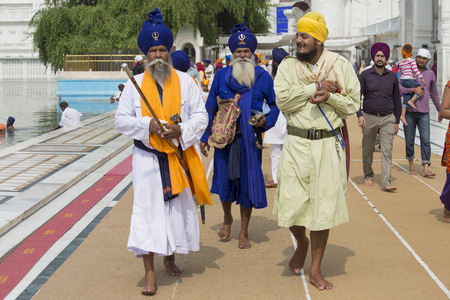 amritsar: AMRITSAR, INDIA - SEPTEMBER 26, 2014: Unidentified Sikhs and indian people visiting the Golden Temple in Amritsar, Punjab, India. Sikh pilgrims travel from all over India to pray at this holy site