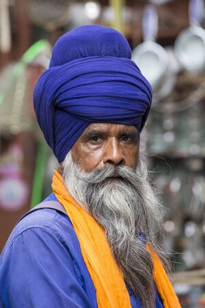 stocky: AMRITSAR, INDIA - SEPTEMBER 26, 2014: Unidentified Sikh man visiting the Golden Temple in Amritsar, Punjab, India. Sikh pilgrims travel from all over India to pray at this holy site.