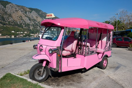 auto rickshaw: KOTOR, MONTENEGRO - SEPTEMBER 23, 2015 : Pink auto rickshaw or tuk-tuk on the street of Kotor. Tuk tuks are commonly used in transporting tourists. This transport is very popular in Thailand and India Editorial