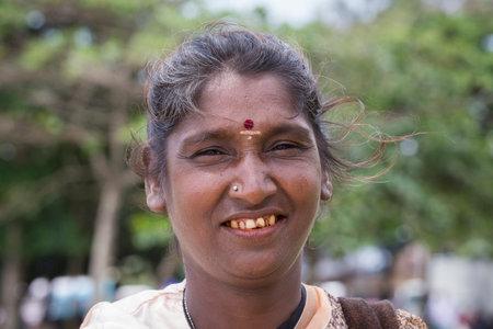 underprivileged: MATARA, SRI LANKA - NOVEMBER 5, 2014: Unknown Sri Lankan beggar woman waits for alms on a street