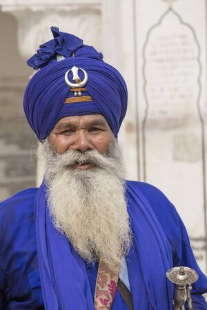 bushy: AMRITSAR, INDIA - SEPTEMBER 26, 2014: Unidentified Sikh man visiting the Golden Temple in Amritsar, Punjab, India. Sikh pilgrims travel from all over India to pray at this holy site.