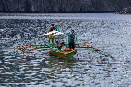 coron: EL NIDO, PHILIPPINES - FEBRUARY 03, 2014: Boat with tourists to travel between the islands. El Nido is one of the top tourist destinations in the world. Editorial