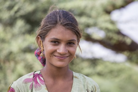 closeup: PUSHKAR, INDIA - OCTOBER 27, 2014: Unidentified girl at the attended the annual Pushkar Camel Mela. This fair is the largest camel trading fair in the world.