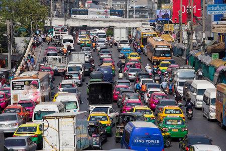 traffic: BANGKOK, THAILAND - JANUARY 22, 2015: Traffic moves slowly along a busy road in Bangkok, Thailand. Annually an estimated 150,000 new cars join the already heavily congested streets of Bangkok.