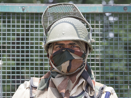 frontier: SRINAGAR, INDIA - JUNE 11, 2015:  Unknown Indian frontier guard. Indian Army checkpoint in Kashmir Himalayas. Kashmir became dangerous again.