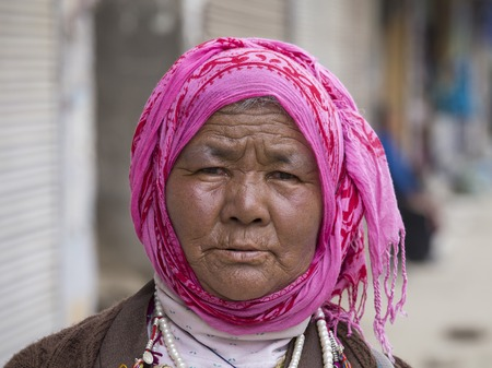 hobo: LEH, INDIA - JUNE 21, 2015: Unidentified beggar woman on the street in Leh, Ladakh. Poverty is a major issue in India