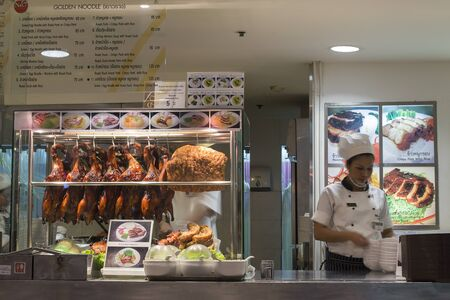 paragon: BANGKOK,THAILAND - NOVEMBER 19, 2013 :Section meal with duck, pork, soups, noodles in Siam Paragon Mall in Bangkok. With 300,000 sq m of retail space Siam Paragon is one of the worlds largest malls. Editorial