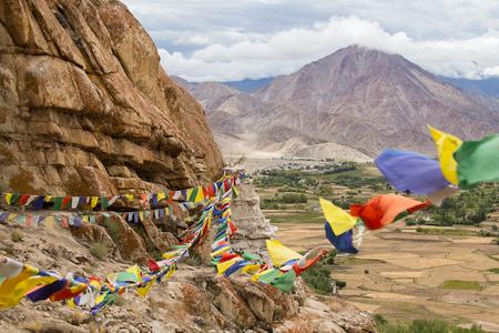 tibetian: Plenty of colorful Buddhist prayer flags on the Stupa near Takthok gompa, Buddhist monastery in Ladakh, Jammu Kashmir, India Stock Photo