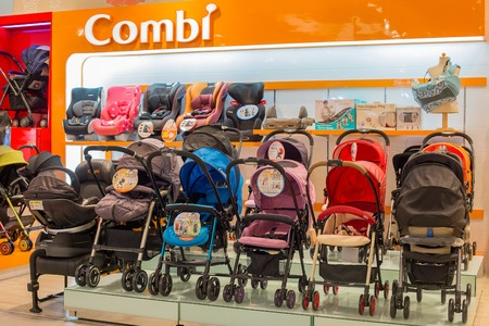 paragon: BANGKOK, THAILAND - JANUARY 7, 2016 : Section of baby carriages Combi in supermarket Siam Paragon. Siam Paragon is a one of the biggest shopping centres in Asia. Editorial