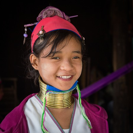 necked: INLE LAKE, MYANMAR - JANUARY 12, 2016: Padaung Tribal woman poses for a photo in Inle lake, Myanmar, Burma The Padaung-Karen long-necked tribe women are minority of Myanmar. Editorial