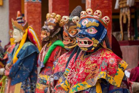 dance time: LAMAYURU, INDIA - JUNE 13, 2015: An unidentified buddhist lamas dressed in mystical mask dancing Tsam mystery dance in time of Yuru Kabgyat Buddhist festival at Lamayuru Gompa, Ladakh, North India