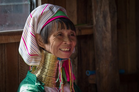 necked woman: INLE LAKE, MYANMAR - JANUARY 14, 2016: Padaung Tribal woman poses for a photo in Inle lake, Myanmar, Burma The Padaung-Karen long-necked tribe women are minority of Myanmar. Editorial