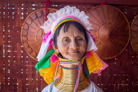 necked woman: INLE LAKE, MYANMAR - JANUARY 14, 2016: Padaung Tribal woman poses for a photo in Inle lake,  Burma The Padaung-Karen long-necked tribe women are minority of Myanmar. Editorial