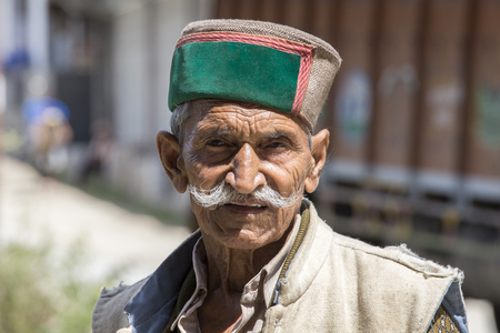 MANALI, INDIA - SEPTEMBER 14, 2014: Old unidentified local man, outdoor in Manali . The majority of the local population are descendant of Tibetan.