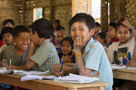 local 27: MRAUK-U, MYANMAR - JANUARY 27, 2016: Unidentified Burmese girls and boys in a local school during the lesson