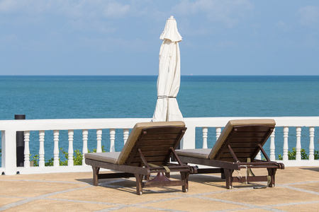 two chairs: Two chairs beds on tropical beach with blue ocean in background