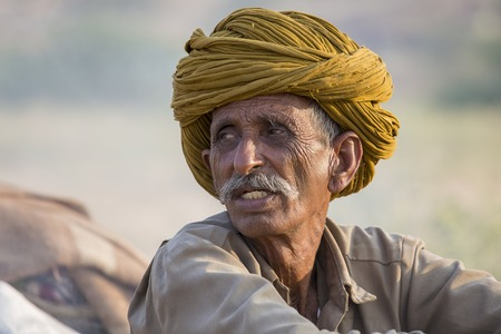 indian fair: PUSHKAR, INDIA - OCTOBER 27, 2014: Unidentified Indian man attended the annual Pushkar Camel Mela. This fair is the largest camel trading fair in the world.