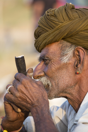 thar: PUSHKAR, INDIA - OCTOBER 27, 2014: Unidentified Indian man attended the annual Pushkar Camel Mela. This fair is the largest camel trading fair in the world.