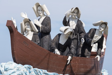catholic nuns: Monument to the nuns on the waterfront in Dumaguete, Philippines Stock Photo