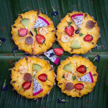 pizza ingredients: Tropical fruit pizza with pineapple, strawberry, kiwi,grapes, banana and dragon fruit