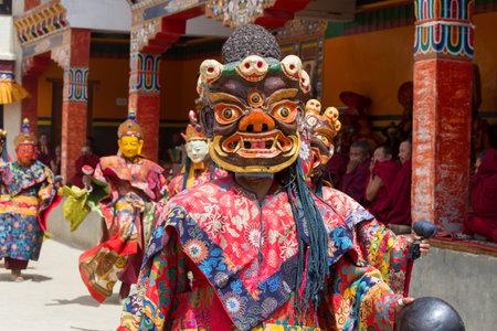 dance time: LAMAYURU, INDIA - JUNE 13, 2015: Unidentified buddhist lamas dressed in mystical mask dancing Tsam mystery dance in time of Yuru Kabgyat Buddhist festival at Lamayuru Gompa, Ladakh, North India