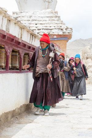 dance time: LAMAYURU, INDIA - JUNE 15, 2015: Unidentified buddhist old women during mystical mask dancing Tsam mystery dance in time of Yuru Kabgyat Buddhist festival at Lamayuru Gompa, Ladakh, North India