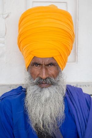 Portrait indian sikh man in turban with bushy beard. Amritsar, India. Close up photo