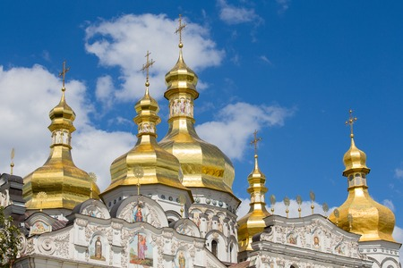 lavra: Gilded dome with a cross in the Assumption Cathedral in Kiev Pechersk Lavra Orthodox monastery, Ukraine Stock Photo