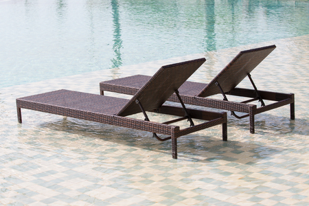 chaise: Two deck chairs in the swimming pool at a tropical resort