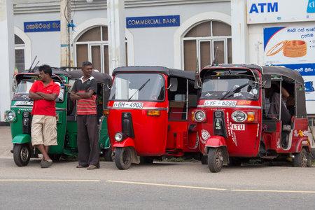 bajaj: HIKKADUWA, SRI LANKA - NOVEMBER 11, 2014:  Auto rickshaw or tuk-tuk on the street of Hikkaduwa. Most tuk-tuks in Sri Lanka are a slightly modified Indian Bajaj model, imported from India.