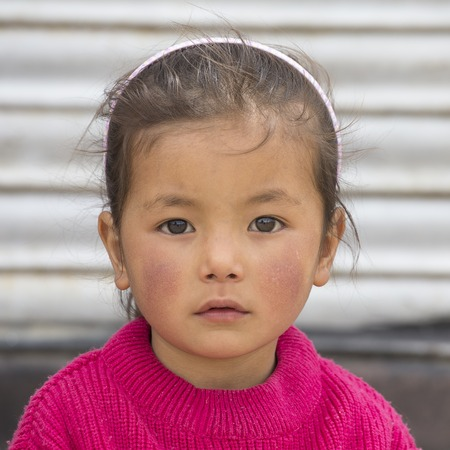 underprivileged: LEH, INDIA - JUNE 24, 2015: Unidentified poor Indian beggar girl on street in Ladakh. Children of the early ages are often brought to the begging profession.
