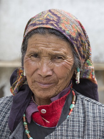 poverty india: LEH, INDIA - JUNE 24, 2015: Unidentified beggar woman on the street in Leh, Ladakh. Poverty is a major issue in India