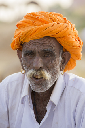 thar: PUSHKAR, INDIA - OCTOBER 28, 2014: Unidentified Indian man attended the annual Pushkar Camel Mela. This fair is the largest camel trading fair in the world.