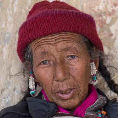 dance time: LAMAYURU, INDIA - JUNE 15, 2015: Unidentified buddhist old woman during mystical mask dancing Tsam mystery dance in time of Yuru Kabgyat Buddhist festival at Lamayuru Gompa, Ladakh, North India Editorial