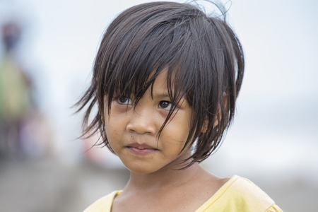 waif: KUTA, BALI, INDONESIA - MARCH 13, 2015 : Unidentified portrait of a little indonesian child at the streets Editorial