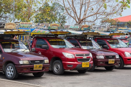 koh samui: KOH SAMUI, THAILAND - APRIL 18, 2016 : Songthaew pick-up truck at Nathon pier in Koh Samui. Songthaews are used as public share taxis in Thailand with set routes. Editorial