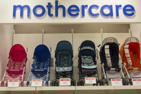 paragon: BANGKOK, THAILAND - JANUARY 7, 2016 : Section of baby carriages Mothercare in supermarket Siam Paragon. Siam Paragon is a one of the biggest shopping centres in Asia.