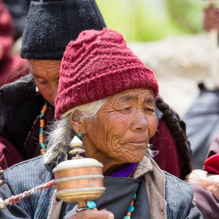 dance time: LAMAYURU, INDIA - JUNE 13, 2015: Unidentified buddhist old people during mystical mask dancing Tsam mystery dance in time of Yuru Kabgyat Buddhist festival at Lamayuru Gompa, Ladakh, North India
