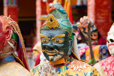 LAMAYURU, INDIA - JUNE 13, 2015: Unidentified buddhist lamas dressed in mystical mask dancing Tsam mystery dance in time of Yuru Kabgyat Buddhist festival at Lamayuru Gompa, Ladakh, North India