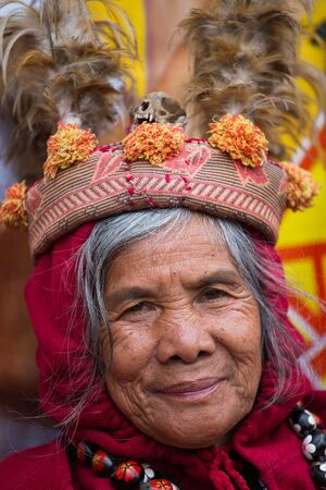 refers: BANAUE, PHILIPPINES - JANUARY 24, 2014 : Unknown old ifugao woman in national dress next to rice terraces. Ifugao - the people in the Philippines. Refers to the mountain peoples. Editorial