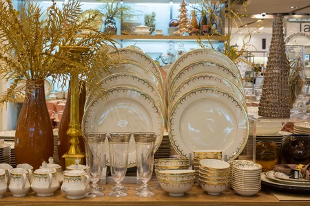centres: BANGKOK, THAILAND - JANUARY 7, 2016 : Section of ceramic tableware in supermarket Siam Paragon. Siam Paragon is a one of the biggest shopping centres in Asia.