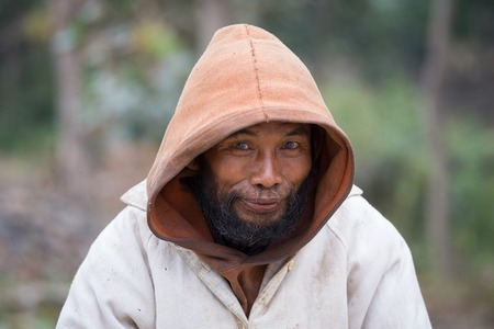 underdeveloped: MRAUK-U, MYANMAR - JANUARY 27, 2016: Unknown portrait beggar man, outdoors, Burma Editorial