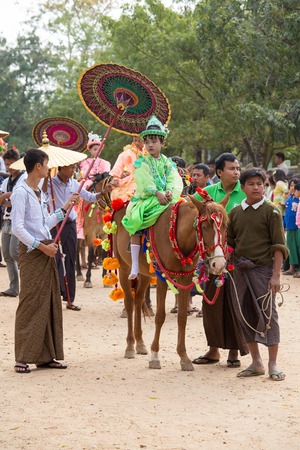 channeled: BAGAN, MYANMAR - JANUARY 21, 2016: Decorated horse, buffalo and local people who participated in the donation channeled ceremony Shinbyu, marking the samanera ordination of a boy under the age of 20
