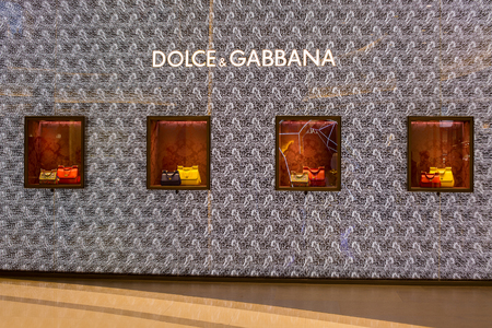 paragon: BANGKOK, THAILAND - JANUARY 07, 2014 : Dolce Gabbana store in Siam Paragon Mall in Bangkok, Thailand. With 300,000 sqm of retail space Siam Paragon is one of the worlds largest malls. Editorial